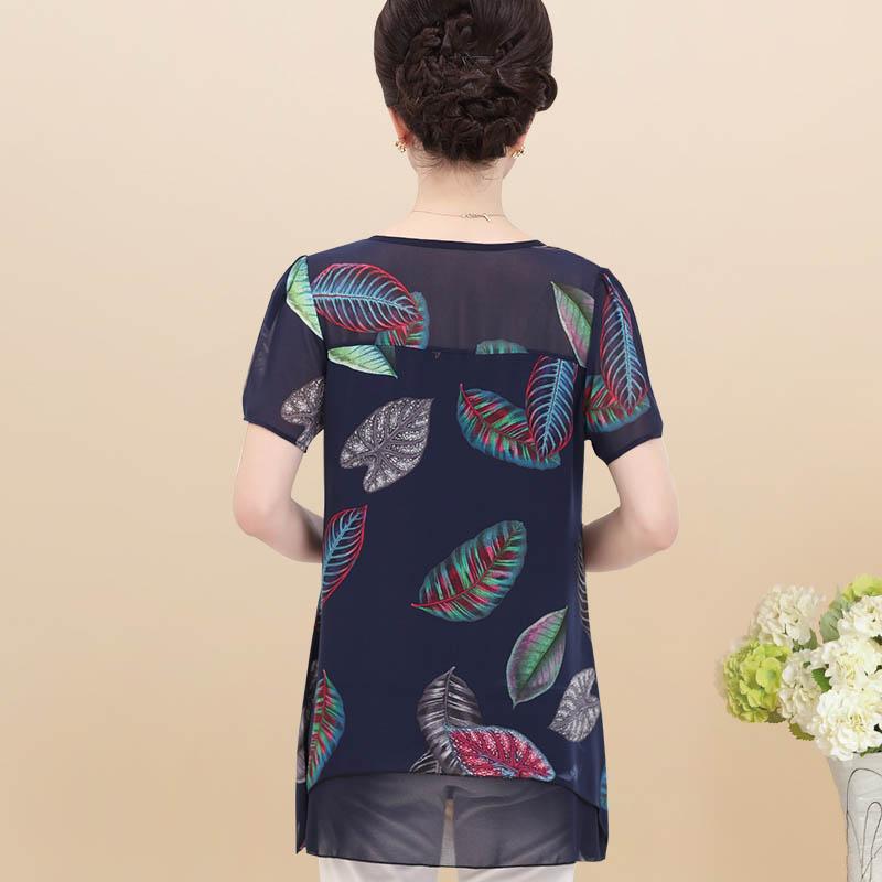 Áo chiffon dáng dài in hoa lá vạt bất đối xứng SMT